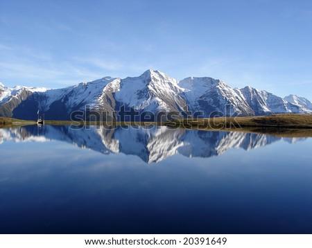 Mountain Reflection Bettmersee Lake In Bernese Alps Switzerland - stock photo