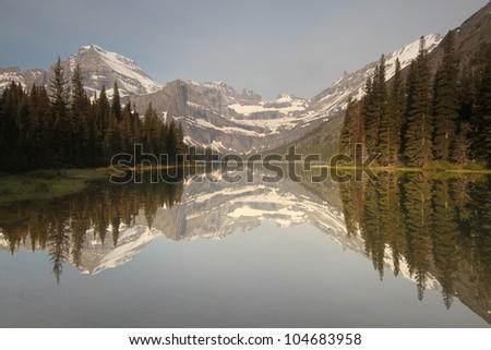 Mountain reflection in lake, Glacier National Park, Montana - stock photo