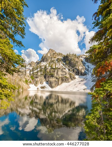Mountain reflection in Trail Creek Lake, in the Sawtooth National Recreation Area, near Stanley, Idaho. - stock photo