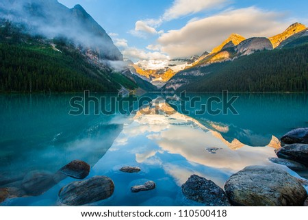 Mountain reflection on lake Louise at sunrise, Banff , canada - stock photo