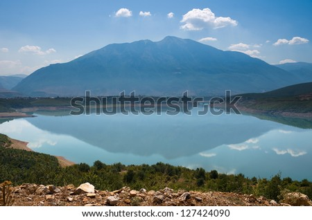 mountain reflection on the Fierza lake near Kukes in northeast Albania
