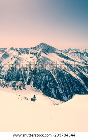 Mountain ridge covered in snow, view from Ankogel, Austria - stock photo