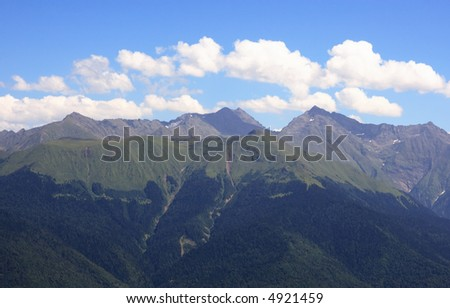 Mountain ridge of Caucasus in summer day