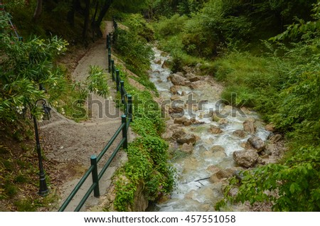 Mountain river along the trail - stock photo