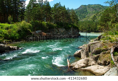 Mountain River among rocks and peaks against the sky and clouds - stock photo