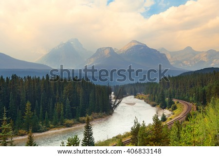Mountain river and railway in Banff National Park - stock photo