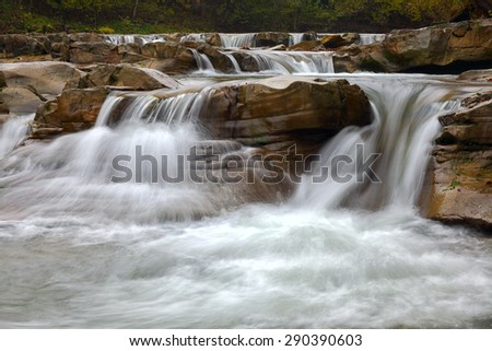 mountain river at summer time. Moution of water