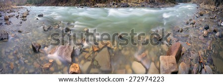 Mountain River Black Cheremosh about Verhovina fast flowing and rocky rapids, Carpathian region - early spring. Ecologically clean water, wild mountains around amid beech and spruce forests and stones