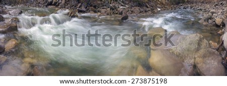 Mountain River Black Cheremosh about Verhovina fast flowing and rocky rapids, Carpathian region - early spring. Ecologically clean water wild mountains around, amid beech and spruce forests and stones