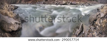Mountain River Black Cheremosh about Verhovina fast flowing and rocky rapids, Carpathian region - early spring. Ecologically clean water wild mountains around, amid beech and spruce forests and stones - stock photo