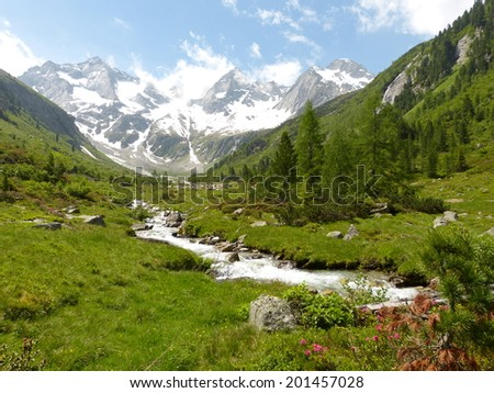 Mountain river from the glacier - stock photo