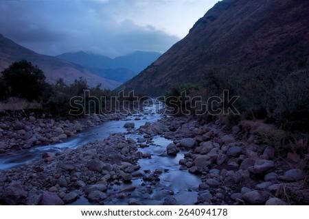 Mountain river in dusk. Shot in Tsehlanyane Nature Reserve, Lesotho. - stock photo