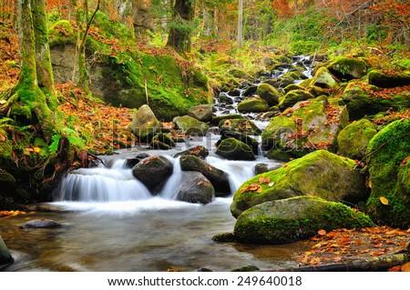 Mountain river in late Autumn - stock photo
