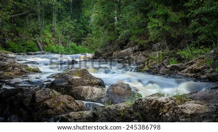 mountain river running over the stones - stock photo