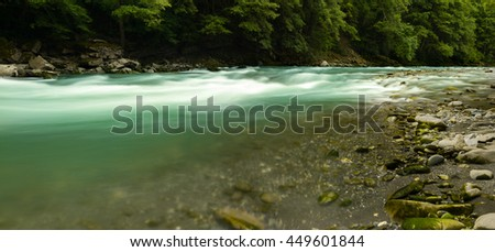 Mountain river with water motion blur