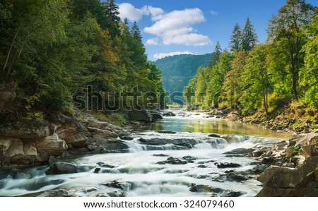 mountain river with waterfall - stock photo
