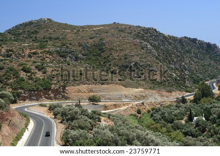 Mountain road and car - stock photo