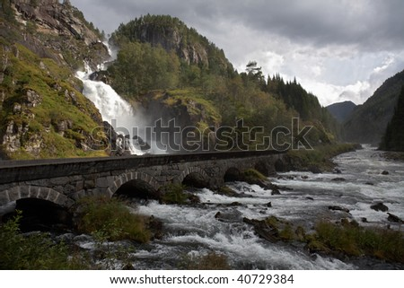 Mountain road and waterfall to southern Norway - stock photo