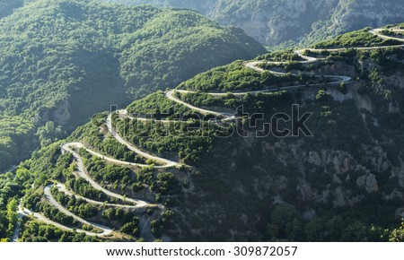 Mountain road at Pindos mountains of Epirus region, in Greece at sunset