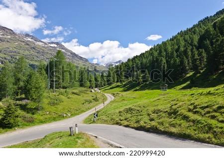 Mountain road in the Italian Alps, 2000 m above sea level - stock photo