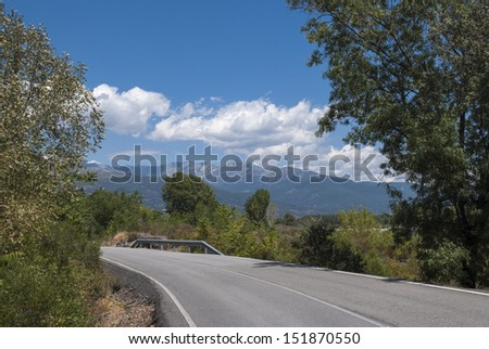 mountain road surrounded by nature