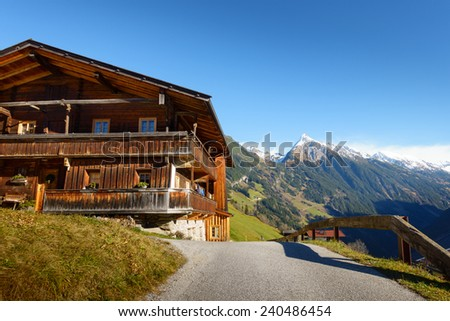 Mountain road to the farmhouse - stock photo