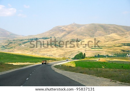 Mountain road with cars in Armenia.