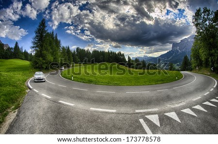 Mountain road with hairpin bend. - stock photo