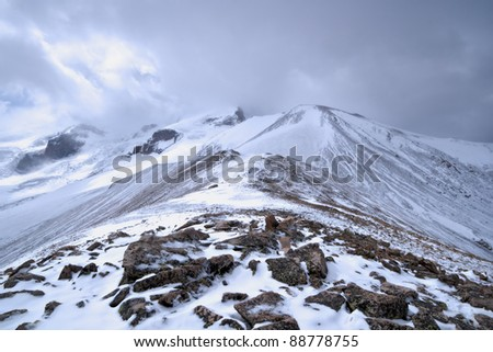 Mountain rocky landscape with stones and snow. Valley in Caucasus mountains. Kabardino-Balkaria. Russia. - stock photo