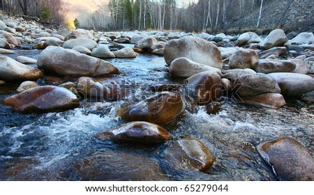 mountain's river amongst large stones - stock photo