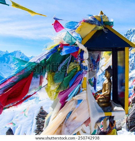 mountain scenery from gokyo ri with prayer flags and buddha statue - Nepal - stock photo