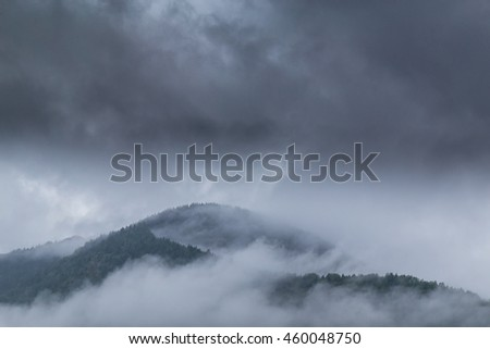 Mountain scenery in the Transylvanian Alps in summer, with mist clouds