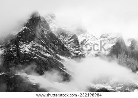 Mountain (Schreckhorn) slowly appearing through the mist, Grindelwald, Switzerland - stock photo