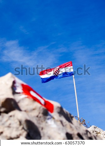 Mountain sign and flag
