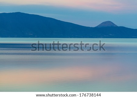 mountain silhouette and  serenity lake - stock photo
