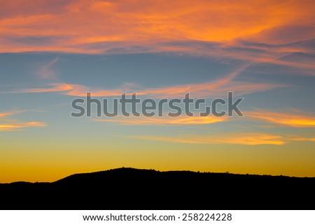 Mountain Silhouette Sunset - stock photo