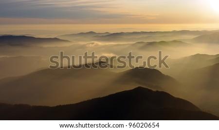 mountain silhouettes at sunset, Romanian Carpathians - stock photo