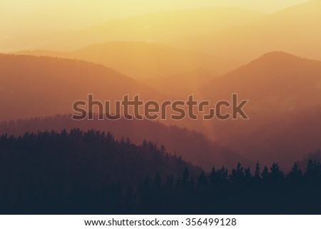 mountain silhouettes at the sunset
