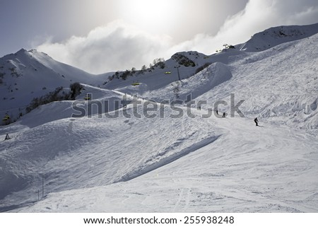 Mountain skitrack on the slope of Caucasus Mountains. Rosa Khutor Alpine Resort in Sochi. Russia. - stock photo