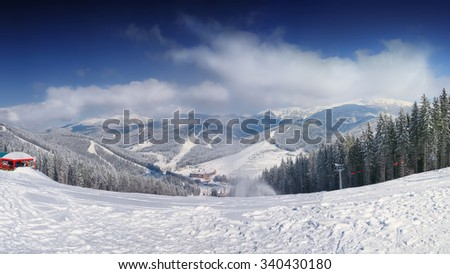 mountain slope at winter time. Dramatic  blue sky - stock photo