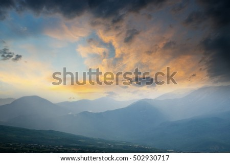mountain spring landscape at dawn.Morning in the mountains on the background of dark dramatic clouds.