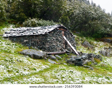Mountain stone shelter for tourist, bivouac, Yading reserve in Daocheng, Sichuan, China - stock photo