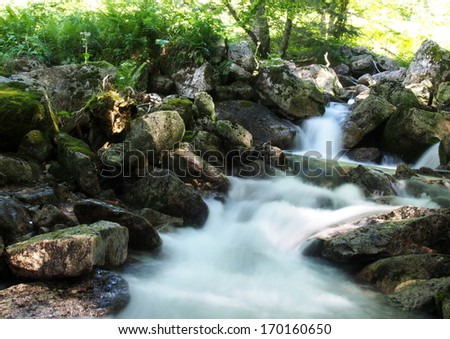 Mountain stream during spring - stock photo