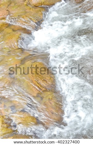 Mountain stream in a tropical rain forest - stock photo