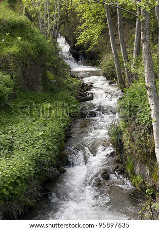 mountain stream in spring - stock photo