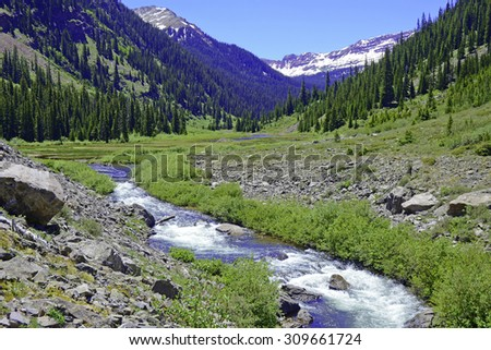 Mountain stream in the Elk Range, Colorado Rockies - stock photo