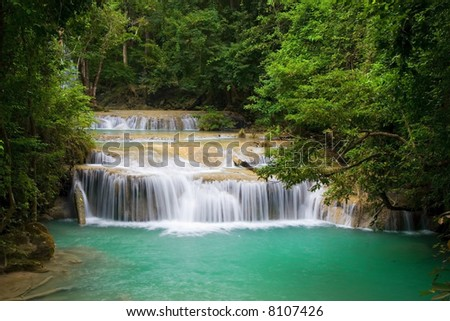 Mountain stream in tropical forest, Erawan National Park, Thailand. - stock photo