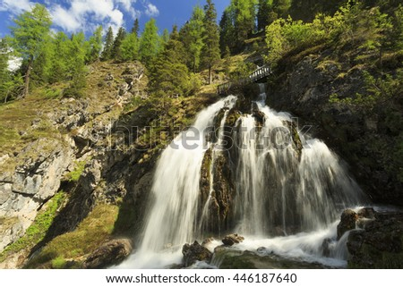 Mountain stream with waterfall, Adamello Brenta Natural Park, Italy