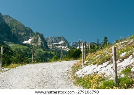Mountain summer trail in the Swiss Alps, Switzerland - stock photo