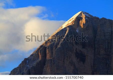 Mountain summit at sunset, Dolomite Alps, Italy - stock photo